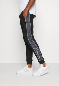 CLOSURE London - CUT SEW CHECKED JOGGER - Spodnie treningowe - black - 3