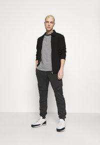 Tigha - BONO - Cargo trousers - vintage black - 1