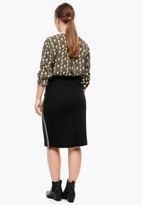 Triangle - A-line skirt - black - 2