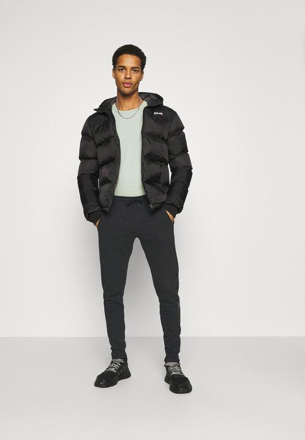 Calvin Klein Jeans MONOGRAM - Spodnie treningowe - black/czarny Odzież Męska RXUK