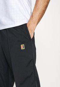 Nike Performance - HERITAGE SUIT PANT - Verryttelyhousut - black - 4