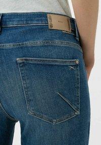 BRAX - STYLE MERRIT - Slim fit jeans - used light blue - 4