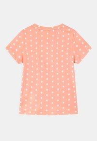 Puma - DOTTED UNISEX - Print T-shirt - apricot blush - 1
