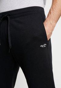 Hollister Co. - CORE  - Teplákové kalhoty - black - 5