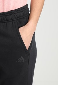 adidas Performance - SOLID - 3/4 sports trousers - noir - 4