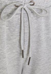 Noisy May Curve - NMMISA PANTS - Tracksuit bottoms - light grey melange - 6
