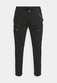 Tigha - FRYCO - Cargo trousers - vintage black - 5