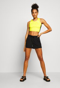 The North Face - WOMENS ACTIVE TRAIL TANKLETTE - Sports shirt - lemon/black - 1