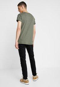 Zalando Essentials - Slim fit jeans - black denim - 2
