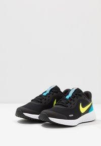 Nike Performance - REVOLUTION UNISEX - Neutral running shoes - black/lemon/laser blue/hyper crimson/white - 3