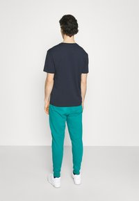 New Balance - ESSENTIALS EMBRIODERED PANT - Tracksuit bottoms - team teal - 2