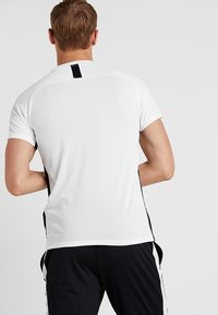 Nike Performance - DRY ACADEMY - Print T-shirt - white/black - 2