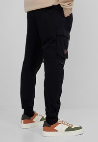 Bershka - Cargo trousers - black - 2