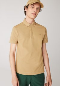 Lacoste - Polo shirt - beige - 0