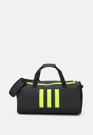 DUFFLE M UNISEX - Sports bag - dough solid grey/black/solar yellow