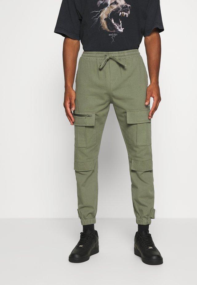 TROUSER HYDRO UNISEX - Cargo trousers - green