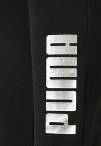 Puma - PANTS - Tracksuit bottoms - black - 2