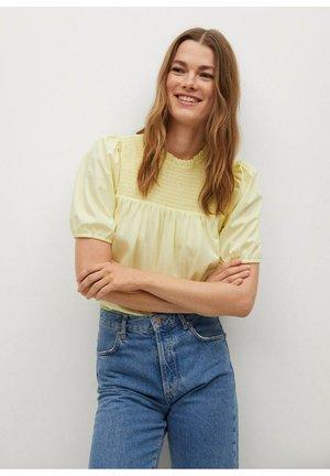 T-shirt con stampa - pastelgeel