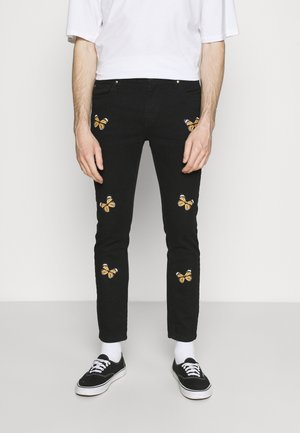 BUTTERFLY - Jeans Tapered Fit - charcoal