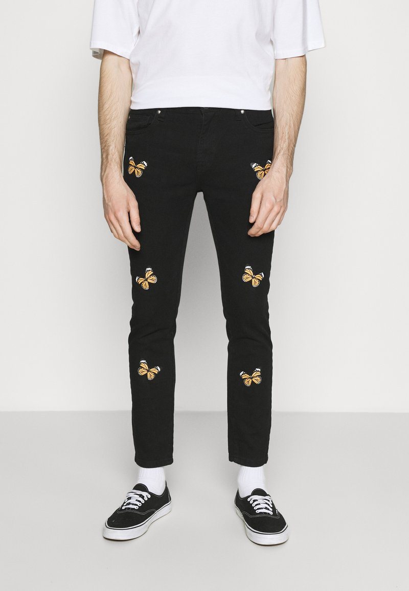 Night Addict - BUTTERFLY - Jeans Tapered Fit - charcoal
