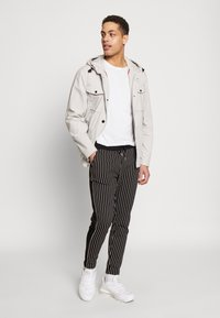 Burton Menswear London - PINSTRIPE - Tracksuit bottoms - black - 1