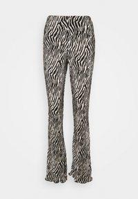 Topshop - ZEBRA PLISSE FLARE - Trousers - monochrome - 0