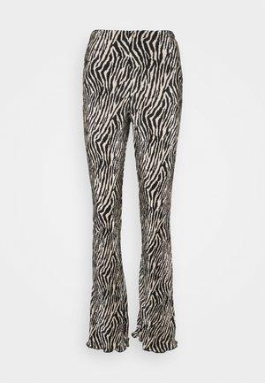 ZEBRA PLISSE FLARE - Trousers - monochrome