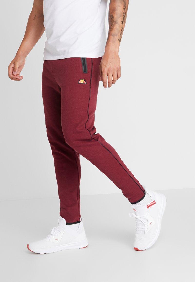 Ellesse - MARTINETTI - Pantalones deportivos - burgundy