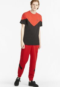 Puma - Tracksuit bottoms - high risk red - 1