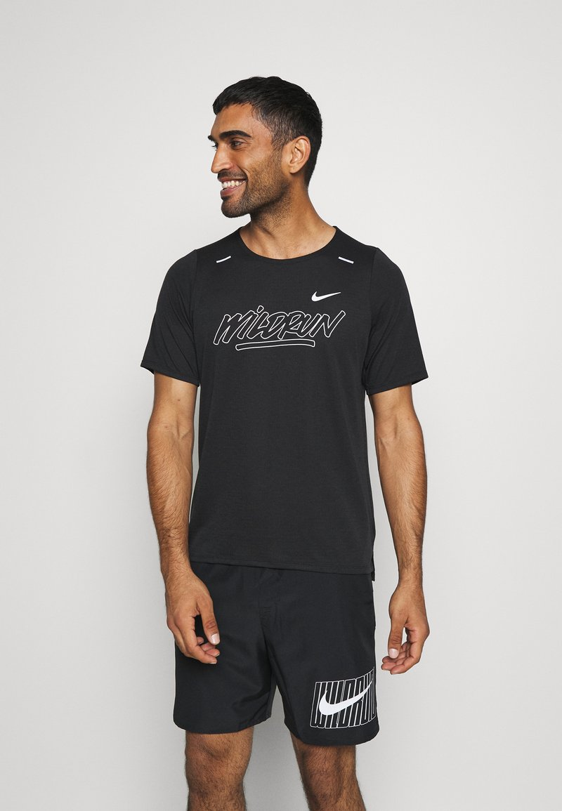 Nike Performance - RISE - Print T-shirt - black/sail