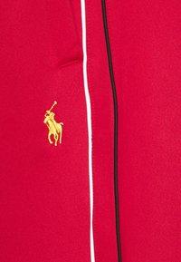 Polo Ralph Lauren - LUX TRACK - Pantalones deportivos - red - 5