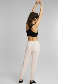 Esprit Sports - Tracksuit bottoms - peach - 6