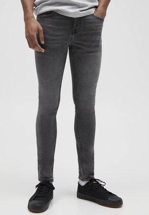 Skinny-Farkut - mottled grey