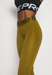 Nike Performance - Leggings - olive flak/olive flak/black - 4