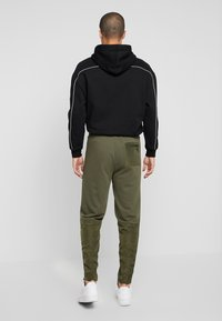Urban Classics - MILITARY - Tracksuit bottoms - olive - 2