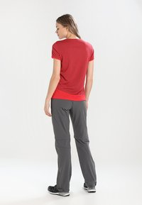 Vaude - WOMEN'S FARLEY STRETCH ZO T-ZIP PANTS 2-IN-1 - Trousers - iron - 2