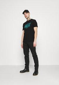 Diesel - DIEGOS UNISEX - Print T-shirt - black - 1