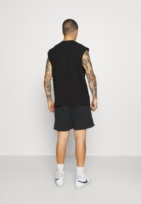 Karl Kani - SMALL SIGNATURE TEE - Basic T-shirt - black - 2