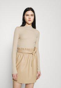 Vero Moda - VMMIA HIGHNECK BODY - Long sleeved top - beige - 0