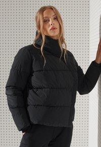 Superdry - FLEX PUFFER - Winter jacket - black - 2