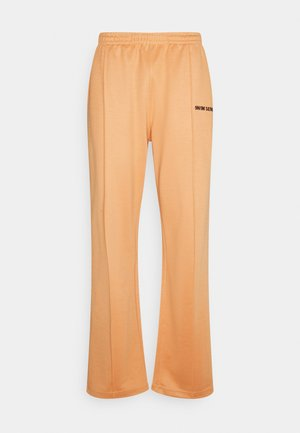 LOGO PANTS UNISEX - Pantalon de survêtement - apricot/black