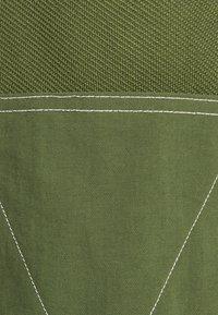 adidas Originals - UNISEX - Tracksuit bottoms - wild pine - 6