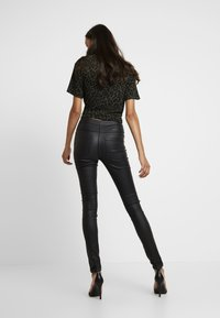 ONLY - ONLROYAL COATED BUTTON PANT - Spodnie materiałowe - black - 3