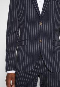 Isaac Dewhirst - BOLD STRIPE SUIT - Suit - dark blue - 6