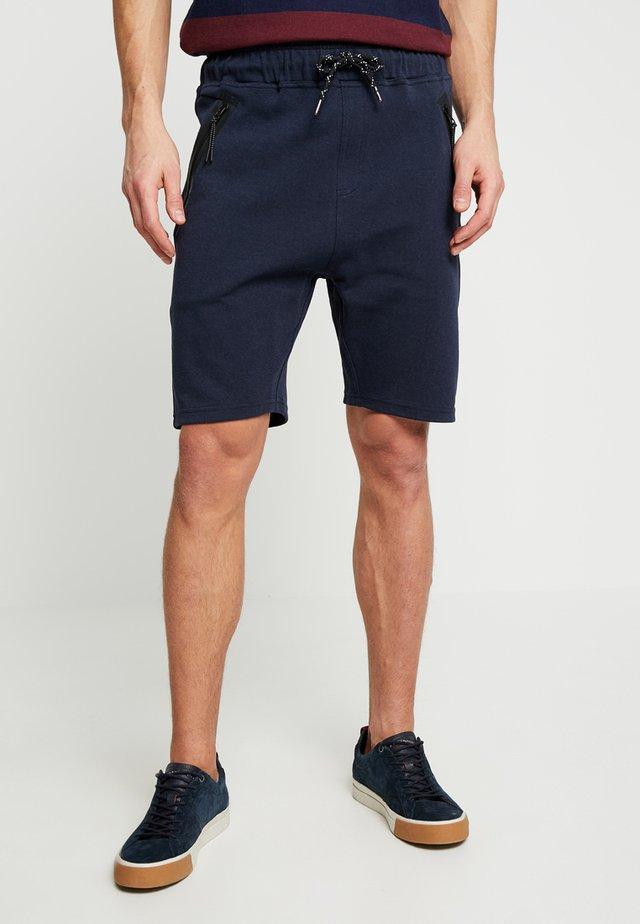 BRAGA - Teplákové kalhoty - navy