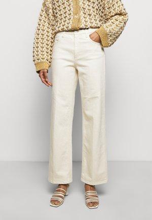 ALBA - Flared jeans - ecru