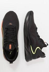 Puma - SOFTRIDE RIFT TECH - Hardloopschoenen neutraal - black/ultra orange - 1