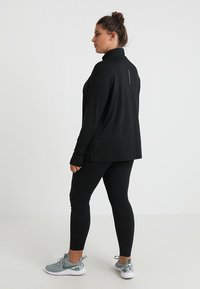 Nike Performance - W NK ELMNT TOP HZ PLUS - Sports shirt - black/reflective silver - 2