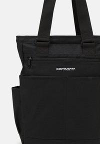 Carhartt WIP - PAYTON KIT BAG UNISEX - Tote bag - black/white - 3