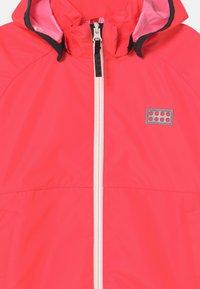 LEGO Wear - JORI 201 JACKET UNISEX - Waterproof jacket - coral red - 3